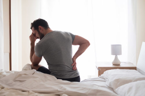 Man feeling backache after suffering personal injury