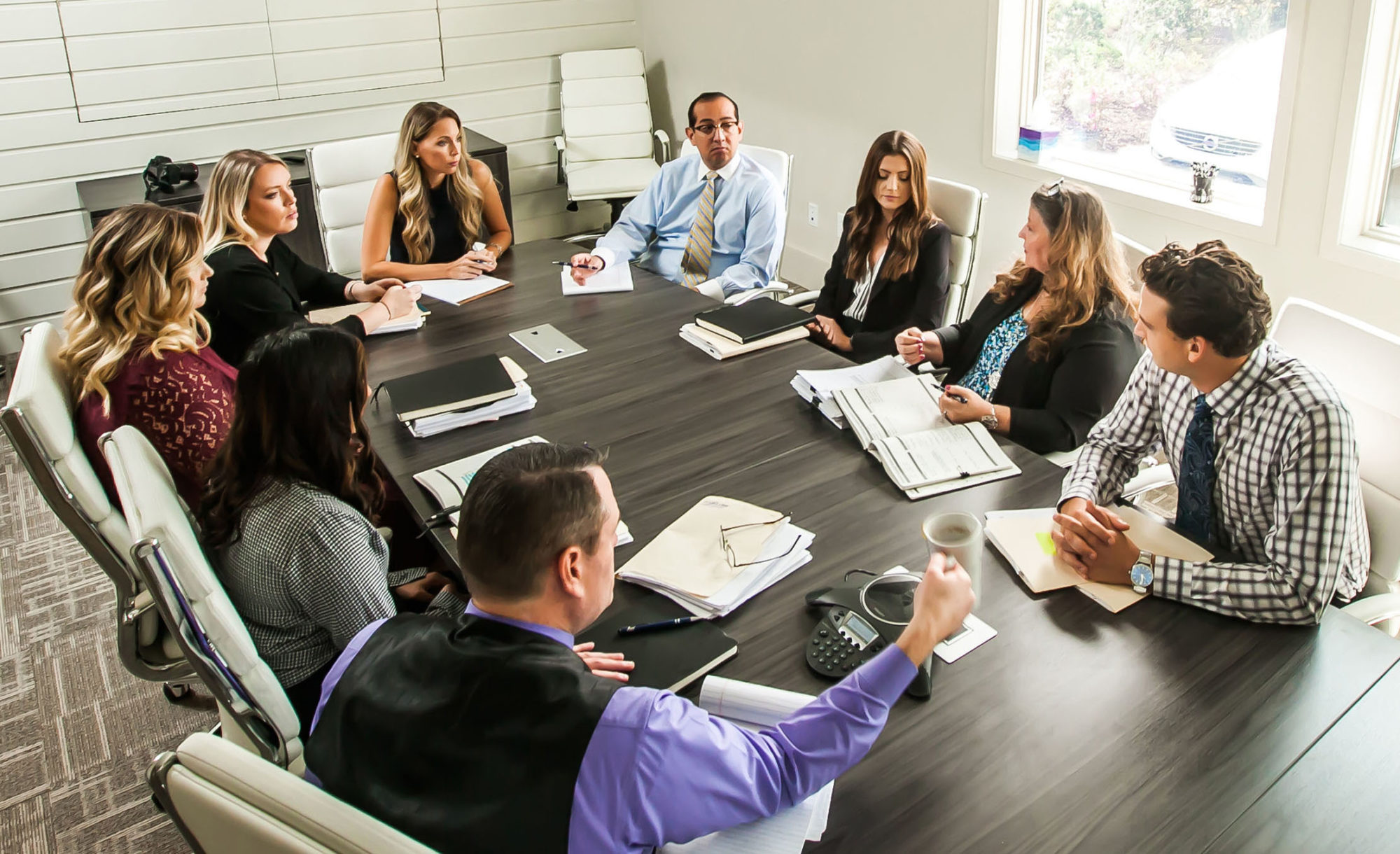 Attorneys and team having a meeting at Speaks Law Firm