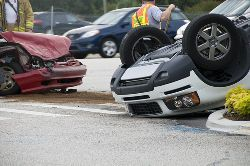 Stock photo of the aftermath of a rollover car accident.