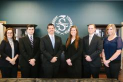Group photo of the attorneys and staff of the Speaks Law Firm in Wilmington, North Carolina.