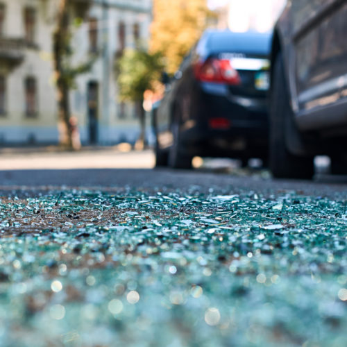 debris in the road after a car accident in Wilmington, NC