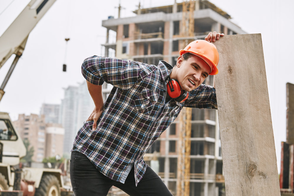 a man experiencing an on-the-job injury at a Wilmington, NC, construction site