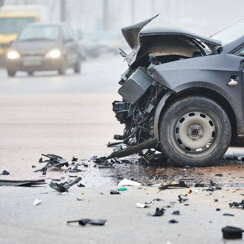 A damaged car in the road after an accident in Charlotte, NC